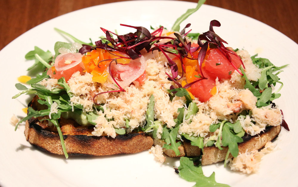 Crab Toast: avocado, citrus, herb olive oil, pickled bell pepper, shallot.