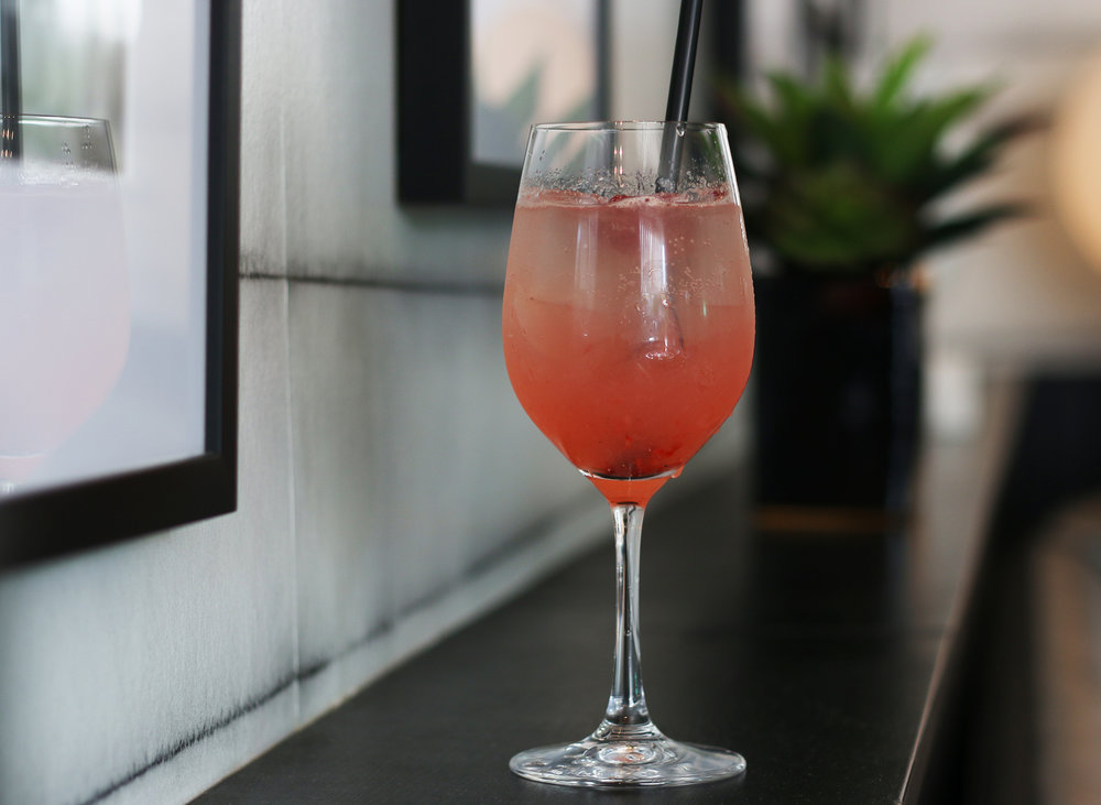 THE LOLITA: Belvedere Cherry Vodka, lemon juice, simple syrup, raspberries, ruffino prosecco, raspberry garnish
