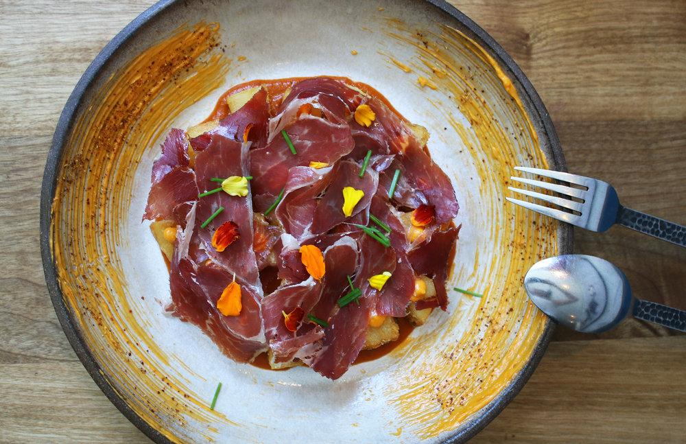 Bravas: crisped kennebec potatoes, chipotle bravas salsa, smoky alioli