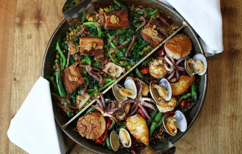 "Two Paellas:  Fideua: paella of rice & noodle, ""the S.F. treat,"" gulf shrimp, scallop, green bean, squid & ink  Lechon: paella, roasted pork shoulder, crispy belly, jamon, saffron, tomato, baby corn, garbanzo"