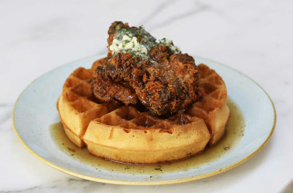 CHICKEN & WAFFLES fried chicken, farm egg, sage butter, maple glaze