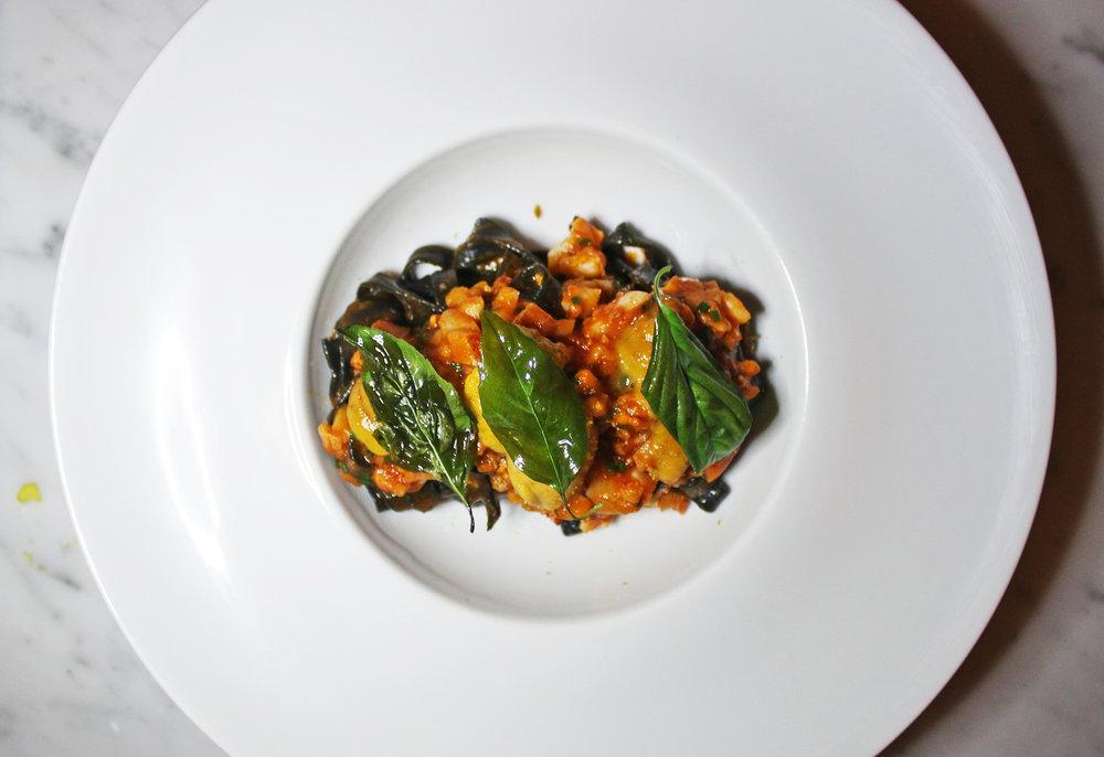 Lobster & Sea Urchin Pasta: Squid Ink Fettucine, Uni Butter, Tarragon, Bottarga