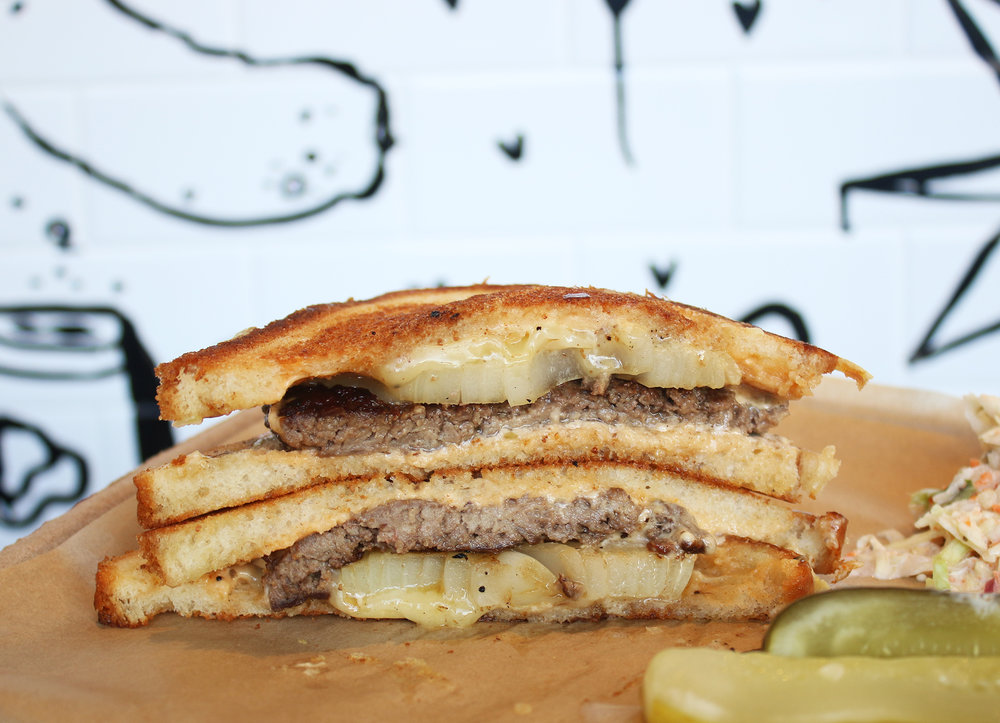 CHOPPED STEAK SANDWICH: Wexler's Brisket Patty, Onion, Raclette, Russian Dressing, Grilled Challah