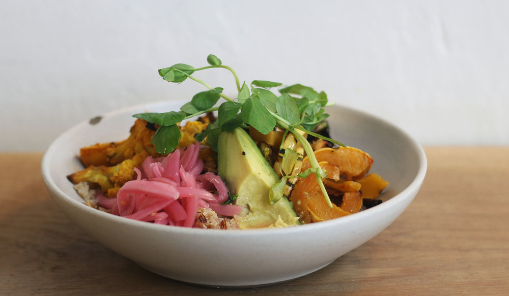 Harvest bowl: Charred brussels sprouts, turmeric roasted cauliflower, delicata squash, shaved almonds, pickled onion, avocado, quinoa, roasted almond vinaigrette (V) (GF)