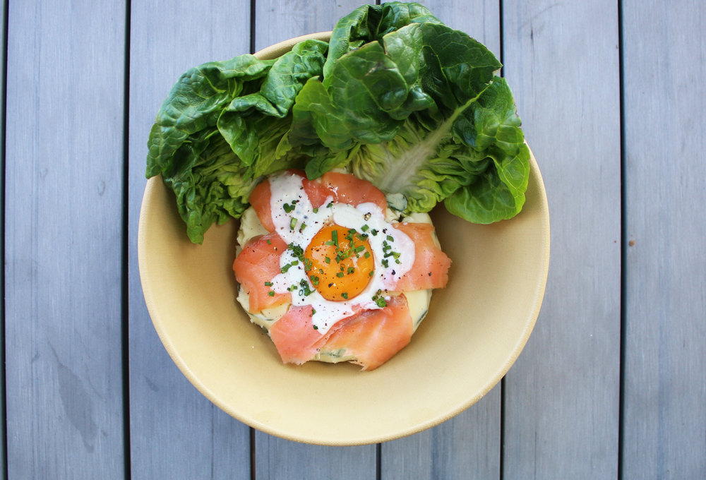 UMI POTATO SALAD: smoked salmon, dill, pickle, truffle blue cheese cream sauce, egg yolk, gem lettuce