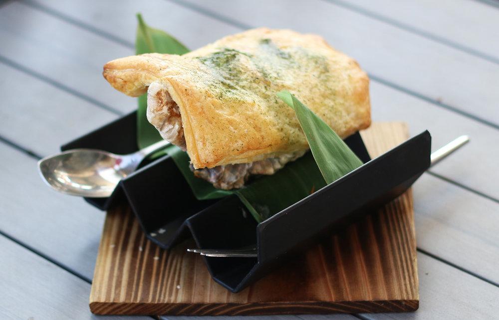 OYSTER DYNAMITE: iwagaki oyster, shimeji mushroom, japanese sausage, mozzarella, pie crust, negi, dynamite sauce