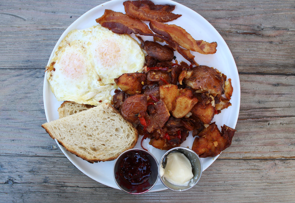 Not-So-Country Breakfast: two eggs, smoky bacon, crispy potatoes, toast & jam