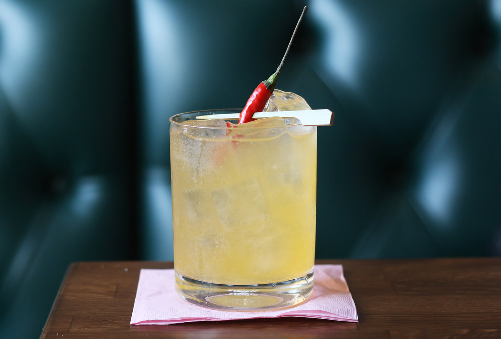 LINDA, LINDA: Delerio Joven Mezcal, orange bell pepper infused Pavan, Thai peppers, lemon