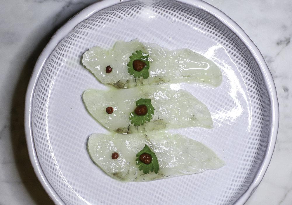 Halibut Yuzu: cilantro, rocoto paste, yuzu, pink peppercorn