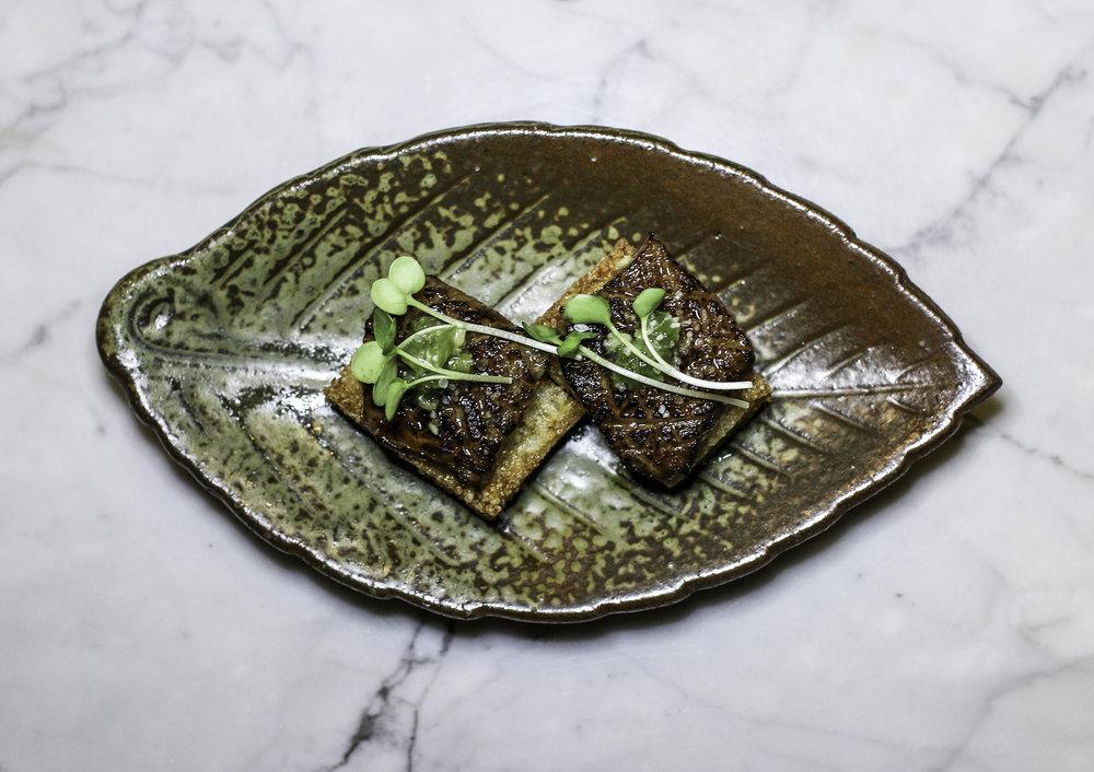Wagyu Biscotti: crispy rice, A5 wagyu beef, pickled wasabi,  sweet soy, daikon sprouts