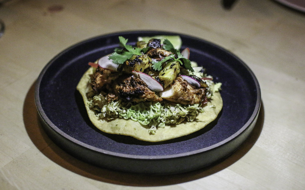 Octopus Al Pastor Tostada: salsa taquero, charred pineapple, shredded cabbage