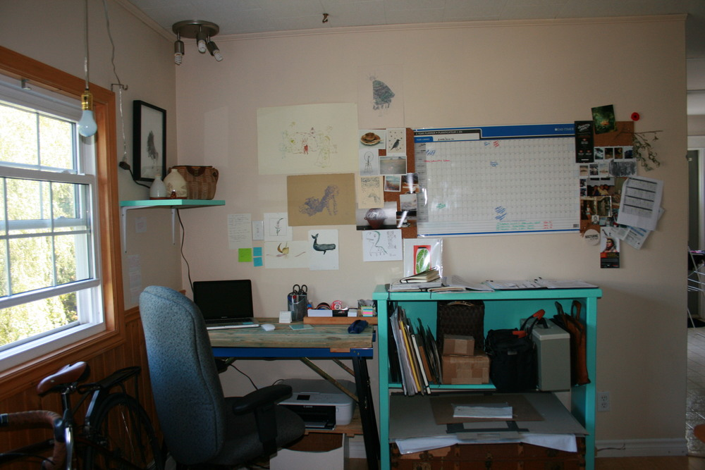 This is my writing and planning space. All the images on my wall are pictures of family and friends and works by my friends who keep me inspired.
