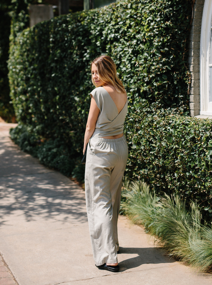 Back detail of a neutral wrap jumpsuit // A Week Of Summertime Minimalist Outfits With Ava Darnell, Founder Of Slumlove Sweater Company on The Good Trade