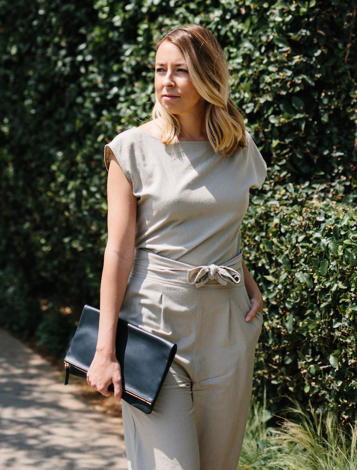 Wrap jumpsuit with black clutch // A Week Of Summertime Minimalist Outfits With Ava Darnell, Founder Of Slumlove Sweater Company on The Good Trade