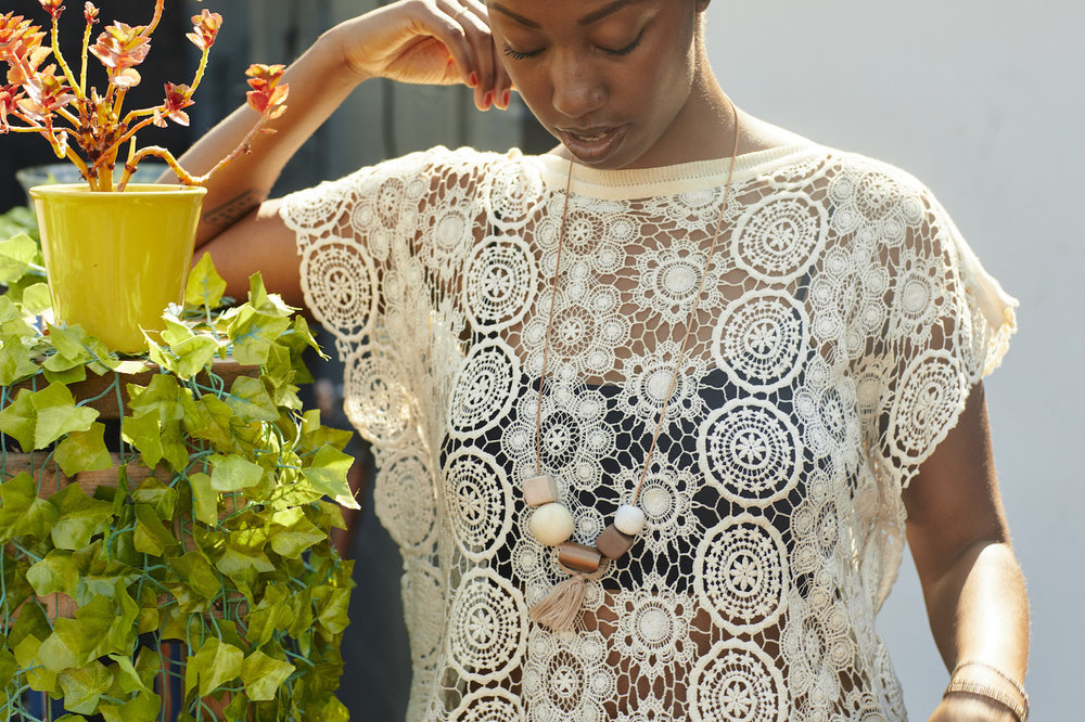 Lace top with beaded necklace // A Week Of Outfits With Dominique Drakeford, Founder Of Melanin & Sustainable Style on The Good Trade