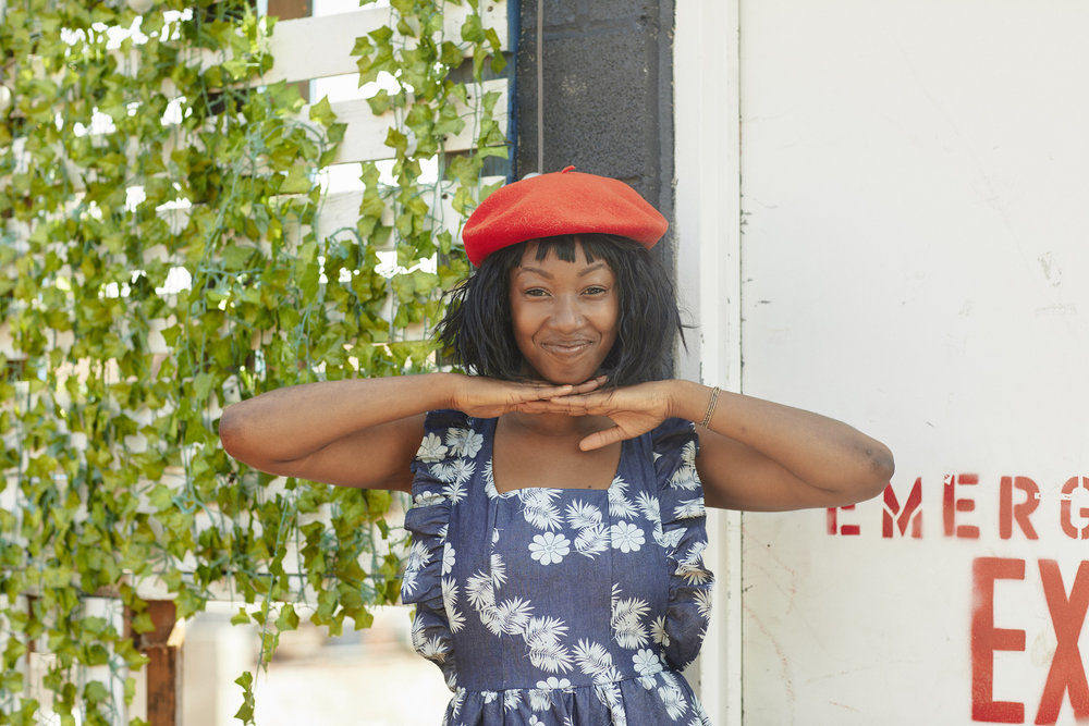 Floral denim dress with red beret // A Week Of Outfits With Dominique Drakeford, Founder Of Melanin & Sustainable Style on The Good Trade