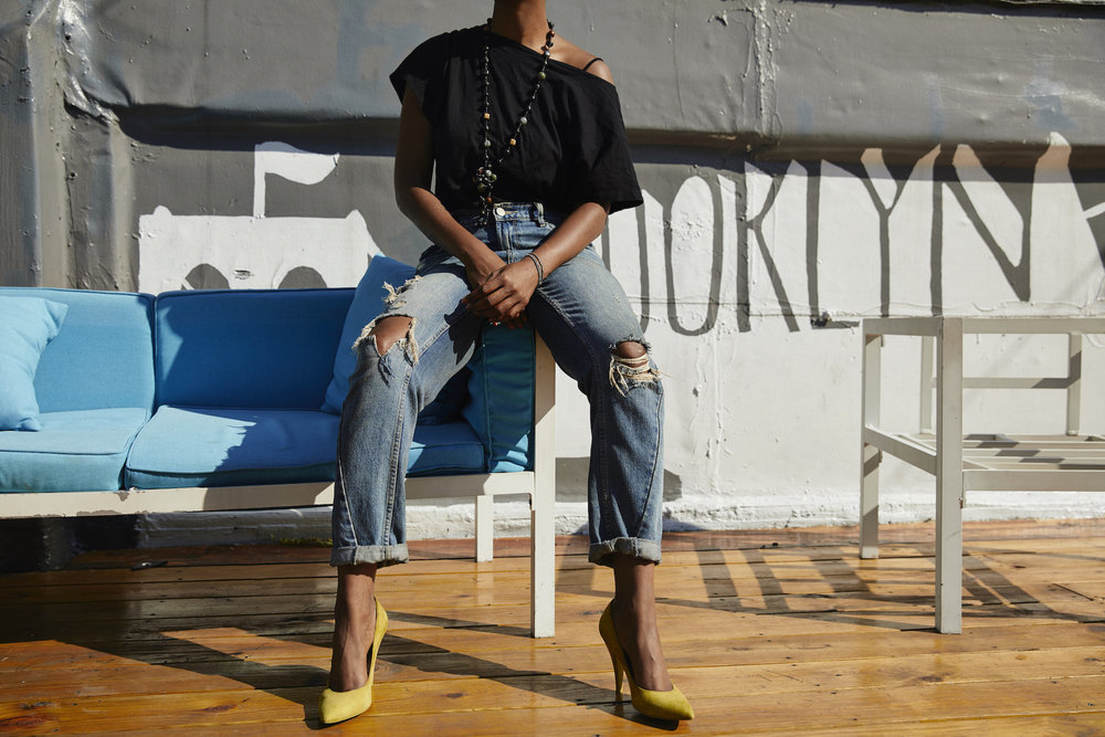 Yellow heels and distressed denim jeans // A Week Of Outfits With Dominique Drakeford, Founder Of Melanin & Sustainable Style on The Good Trade