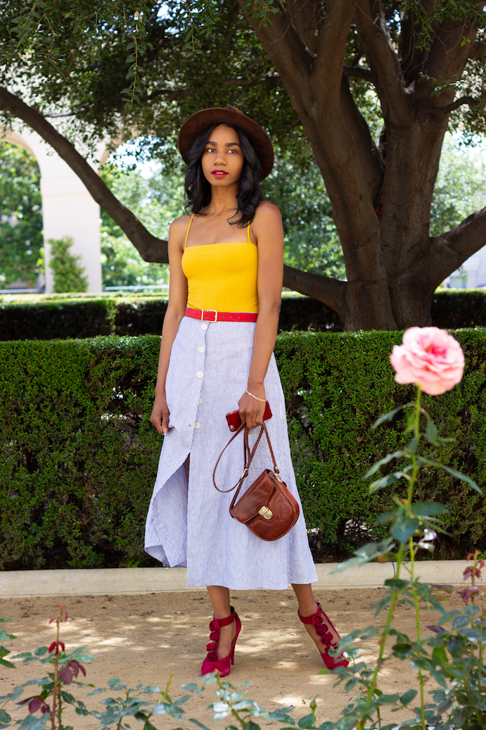 Yellow Reformation bodysuit and button down seersucker skirt // A Week Of Hollywood-Inspired Outfits With Conscious Style Blogger Jeneice Thompson on The Good Trade