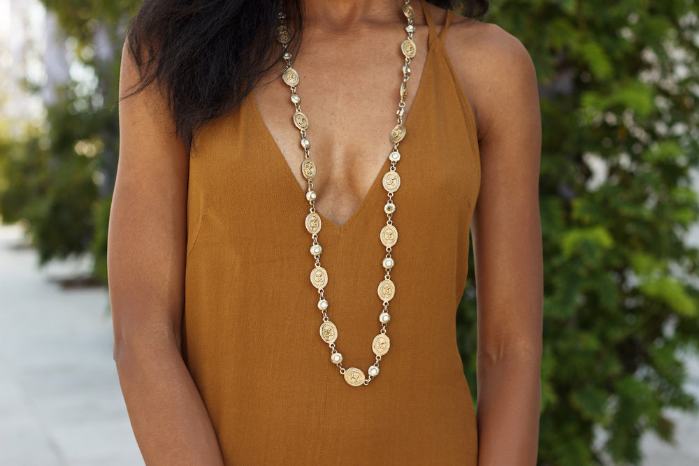 Chanel gold coin necklace with a Reformation dress // A Week Of Hollywood-Inspired Outfits With Conscious Style Blogger Jeneice Thompson on The Good Trade