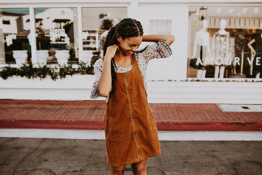Zip-up corduroy dress in rust over a peasant top  // A Week Of 1970s-Inspired Outfits With Leah Thomas, The Sustainable Lifestyle Blogger Behind Green Girl Leah on The Good Trade