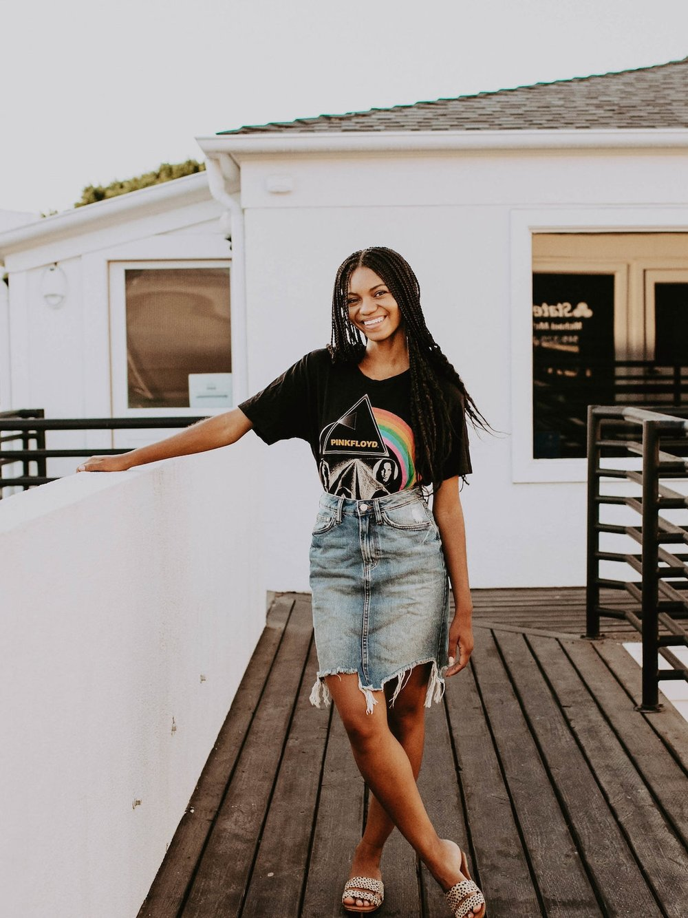 Denim skirt with band t-shirt // A Week Of 1970s-Inspired Outfits With Leah Thomas, The Sustainable Lifestyle Blogger Behind Green Girl Leah on The Good Trade