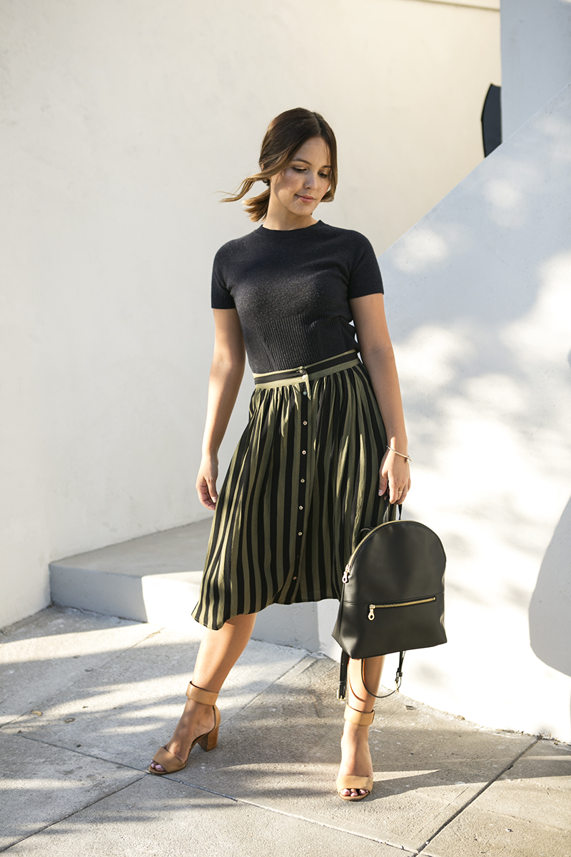 Green and black striped midi skirt thrifted outfit // A Week Of Intentional & Sustainable Outfits With Kasha Cabato From Green With Style on The Good Trade