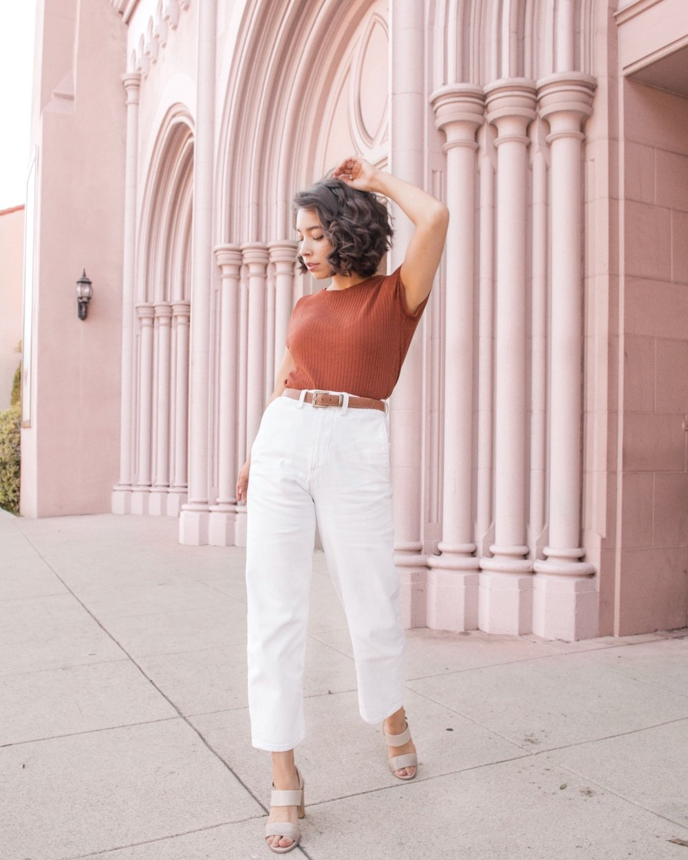 White pants with rust red shirt // A Week Of Self-Expressive Outfits With Aja Duran From Aja With Love on The Good Trade