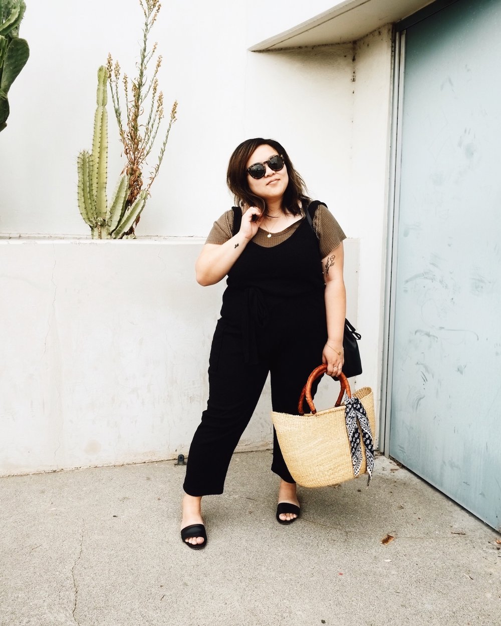 Black jumpsuit with brown top // A Week Of Minimalist Uniform Outfits With Jasmine Hwang From The Pleb Life on The Good Trade