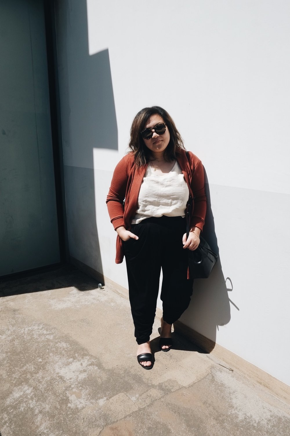 Black, white, and rust red minimalist outfit // A Week Of Minimalist Uniform Outfits With Jasmine Hwang From The Pleb Life on The Good Trade