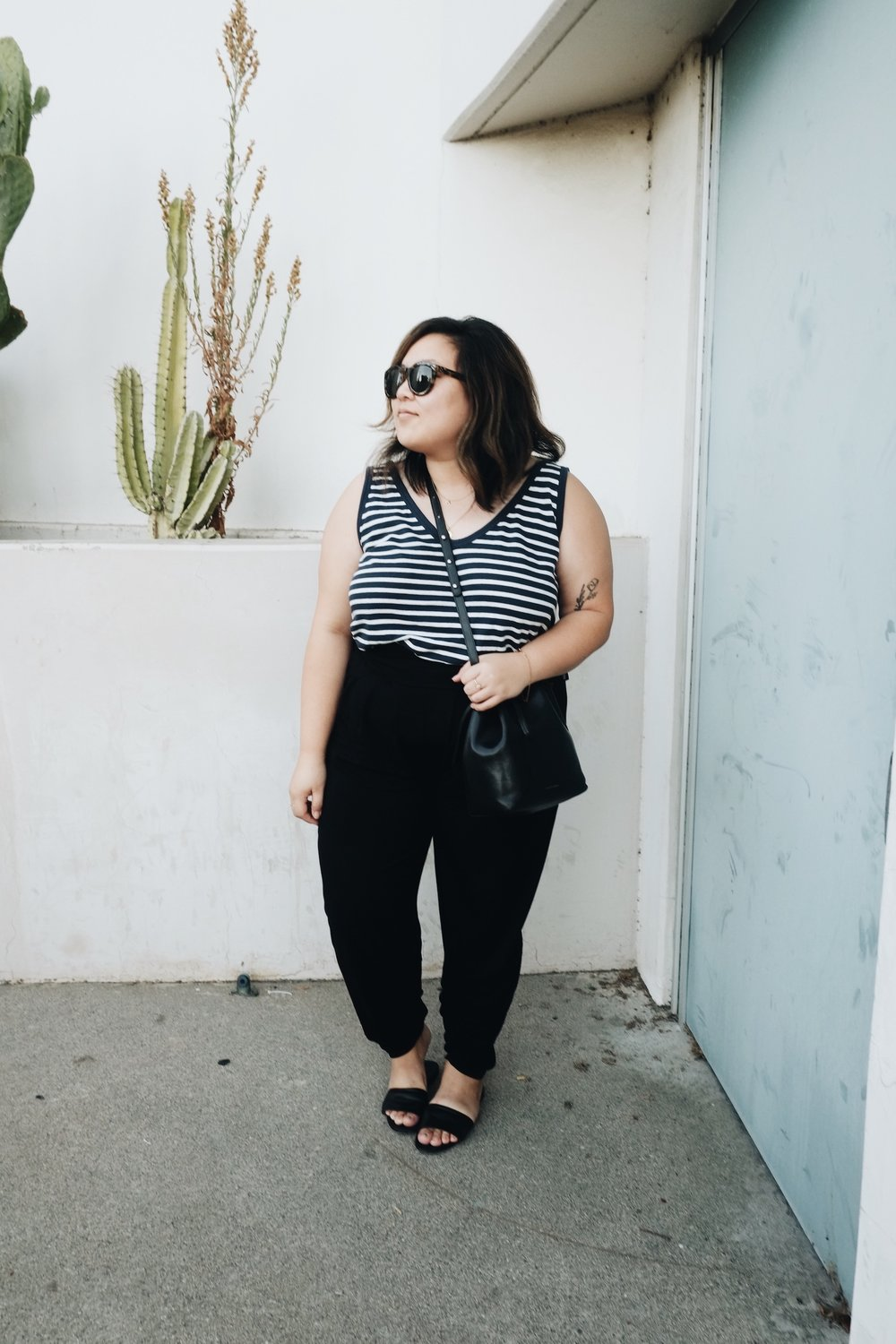 Minimalist outfit idea - striped tee with black pants // A Week Of Minimalist Uniform Outfits With Jasmine Hwang From The Pleb Life on The Good Trade