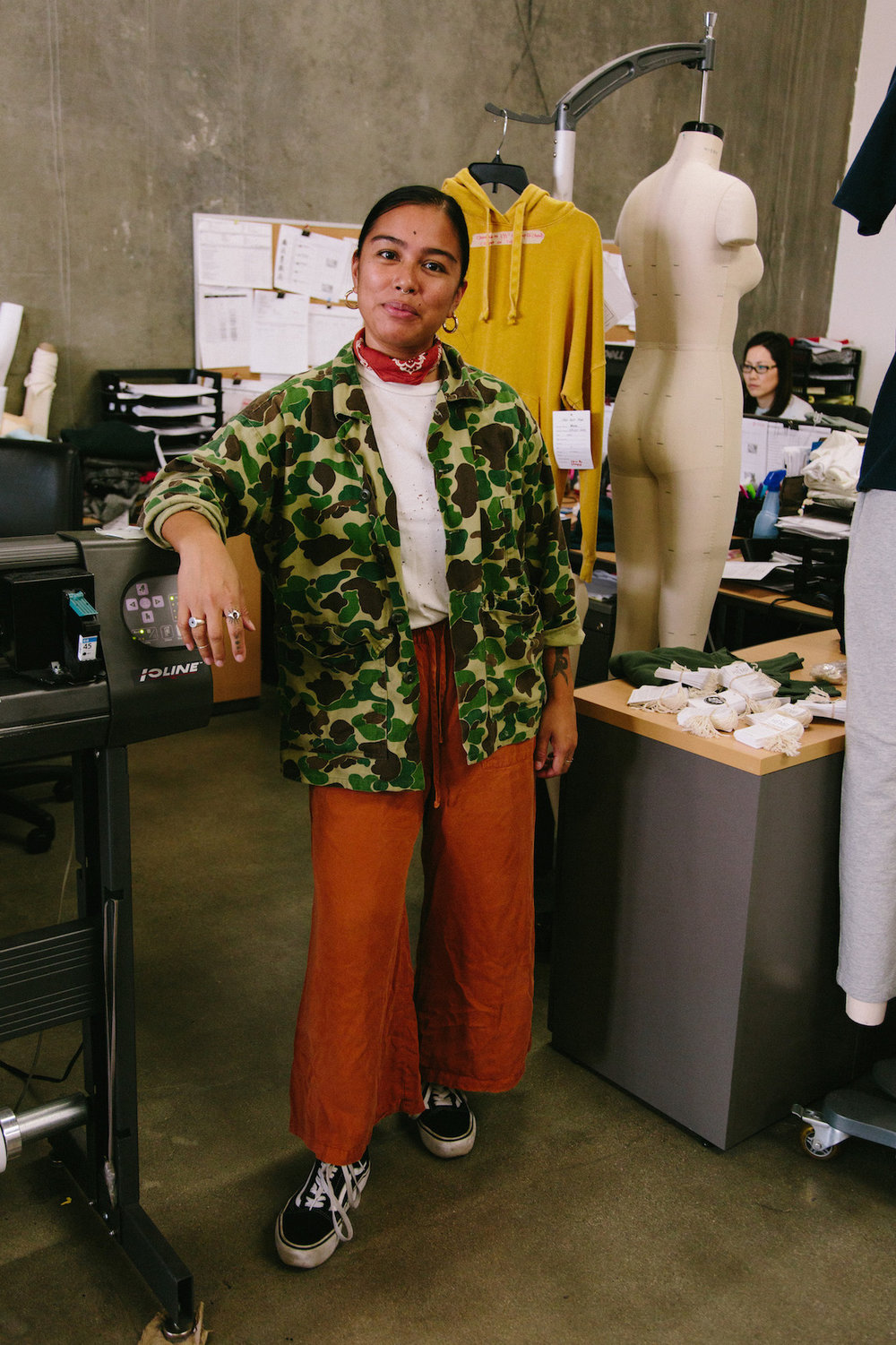Camo jacket and rust orange pants - A Week Of Super-Chill Conscious Fashion With Isadora Alvarez, Founder Of Back Beat Rags on The Good Trade