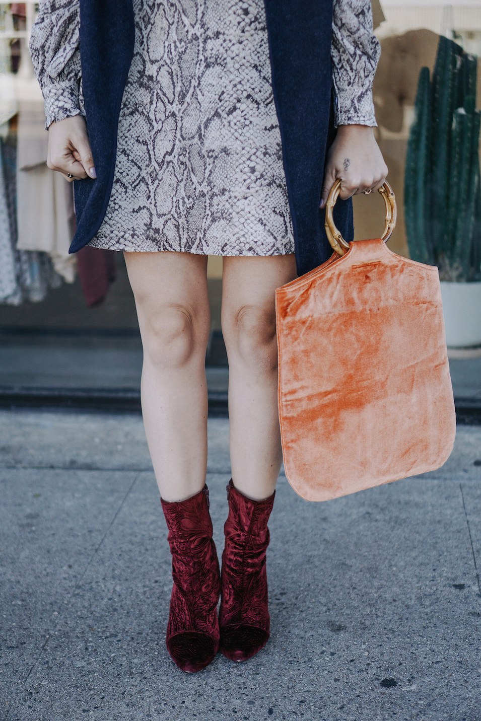 Red velvet booties // A Week Of Uncompromising Sustainable Style With Sonia Kessler From Native Styling on The Good Trade