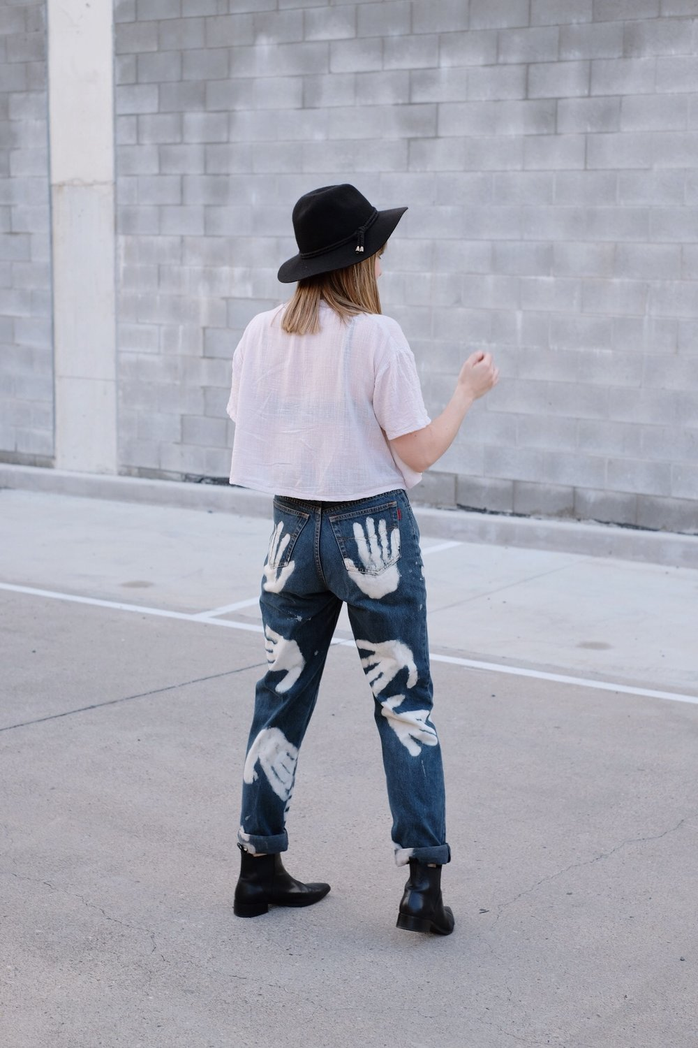 Unique hand printed jeans // A Week Of Colorful & Creative Slow Fashion Outfits With Leah Musch From Un-Material Girl on The Good Trade