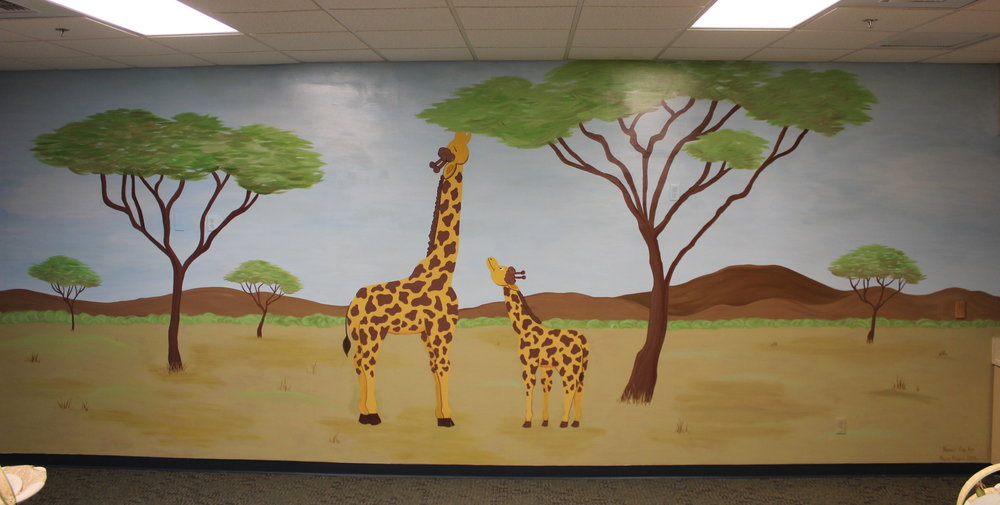 Giraffes in savannah - The Grove Community Church
