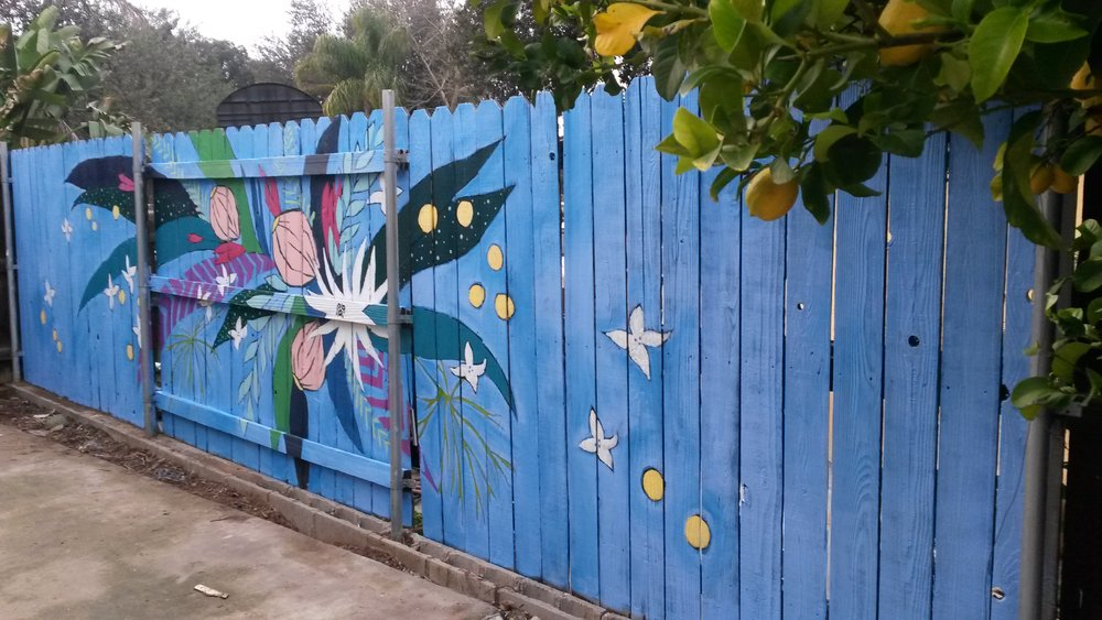 Giant Flowers on Fence