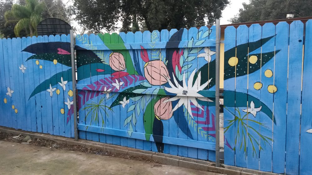 Giant Flowers on Fence - Residential