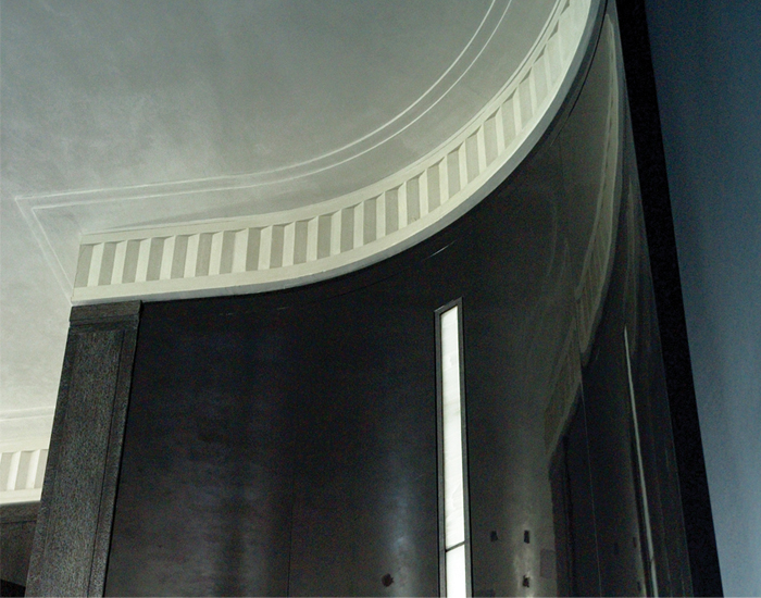 High gloss black lacquer wall panels, custom slot light fixture with wrought iron frame and white onyx lens