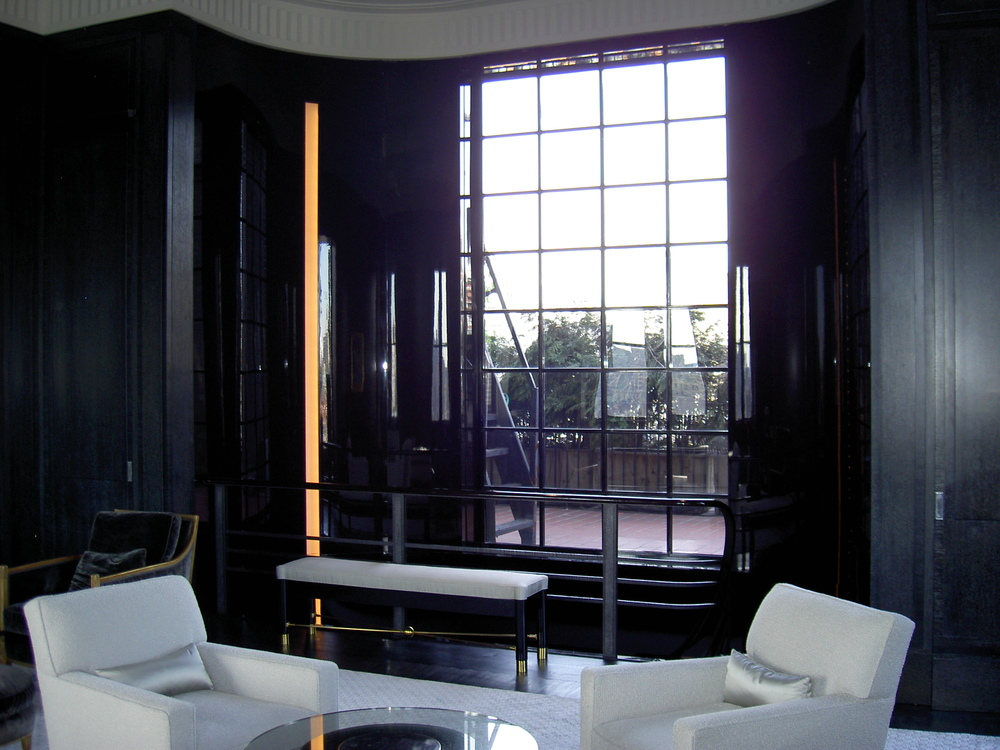 New picture window view to the Empire State Building, cerused oak and high-gloss black lacquer wall paneling