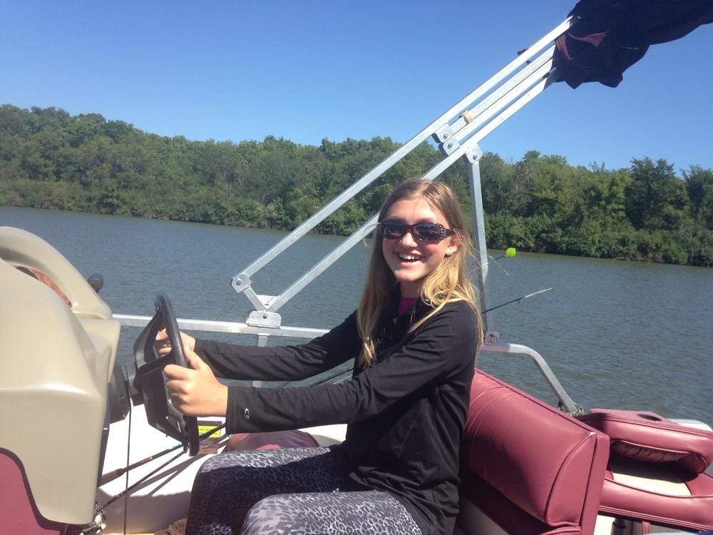 Ashlee-Drives-Boat.jpg