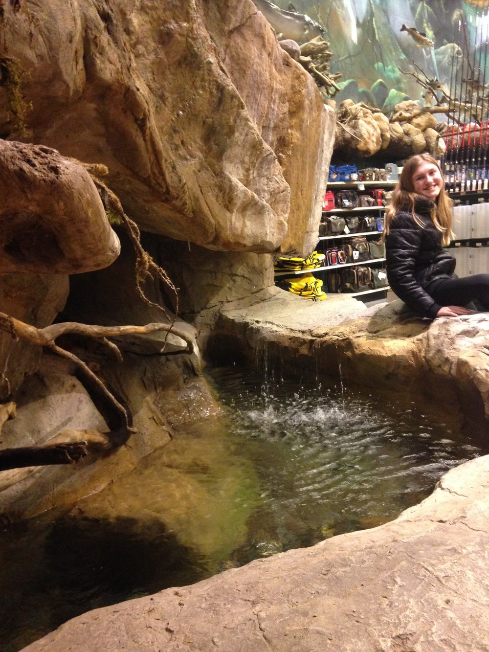 Ashlee-Sitting-by-Bass-Pro-Water.jpg