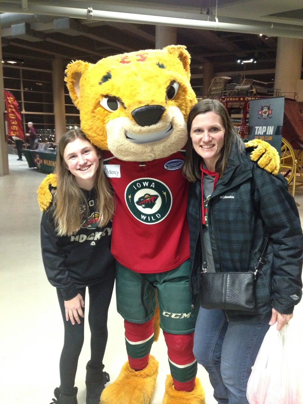 Ashlee-and-Mommy-with-Crash-Iowa-Wild-Hockey.jpg