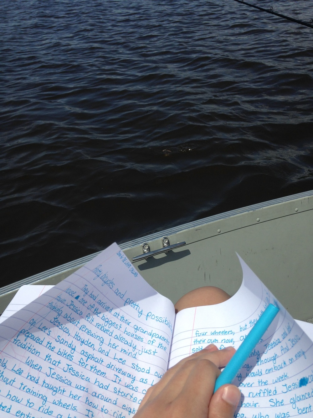 Ashlee-Writing-on-a-Boat.jpg