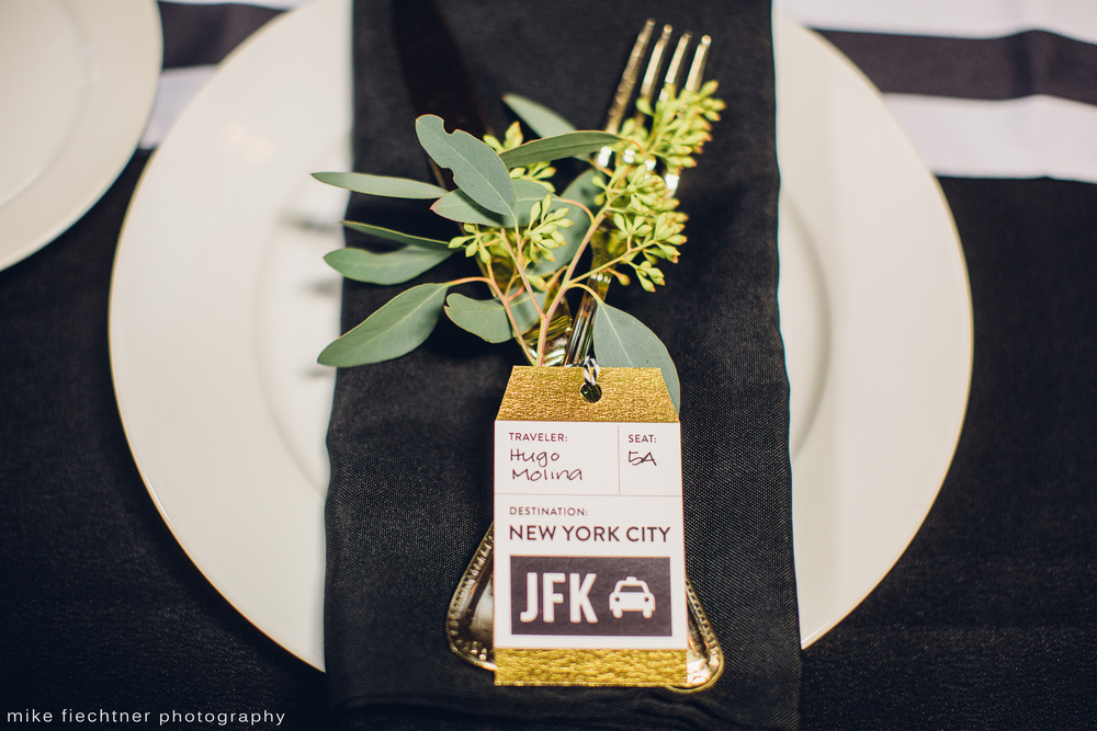 Each guest was thoughtfully seated at tables named after places we'd been, near people they know and love. The place settings included a set of gold flatware and a luggage [name] tag with their name and seat location.