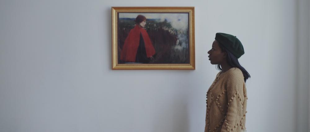 F - simoune contemplates bolu's contemporary work.png