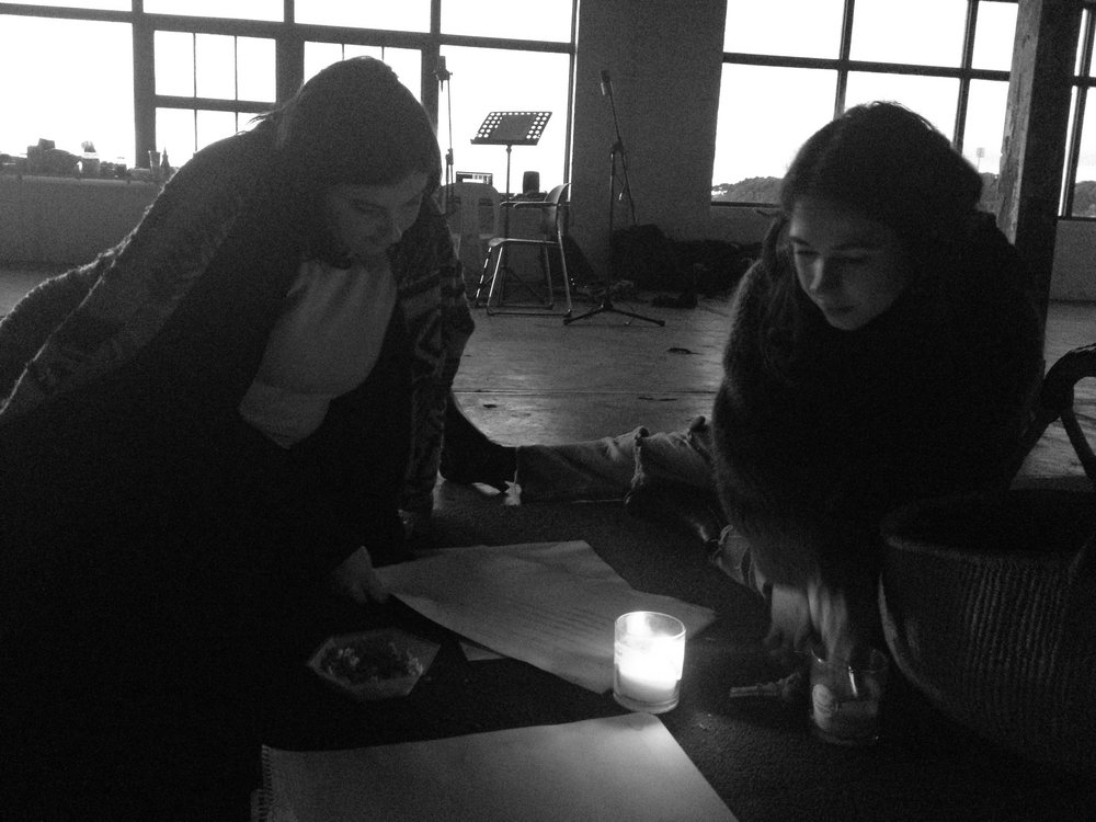Jassy and Tina discussing  Shallow Listening  by candlelight.