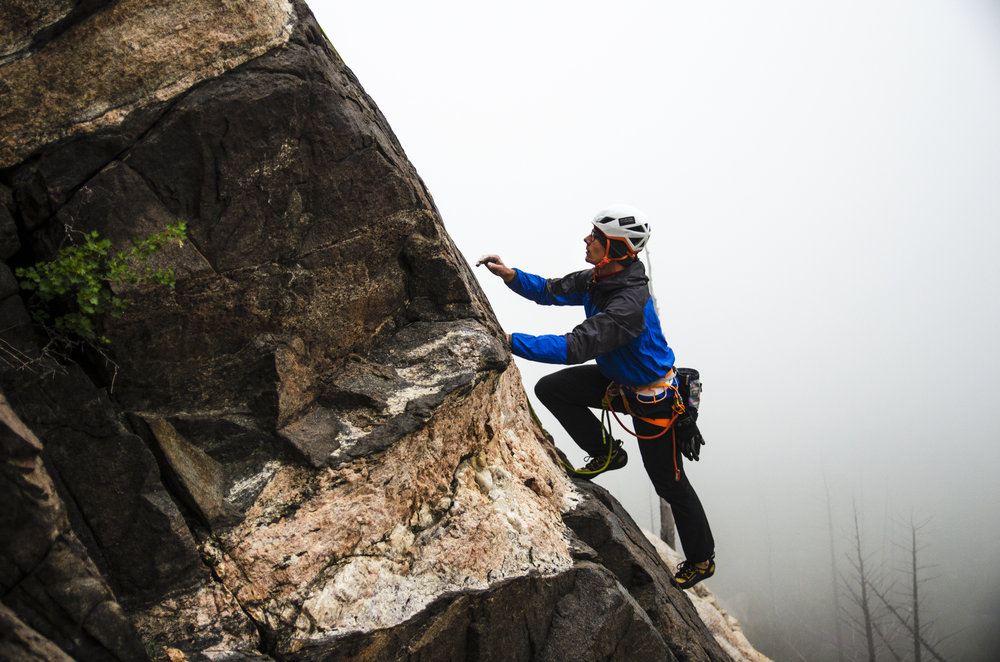 Alton Richardson begins following an unknown route on Double Book Dome, in the rain. Photo by Karissa Frye