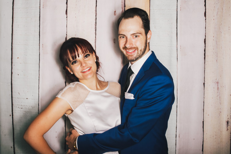 bride-and-groom-brisbane-photo-booth-hire-fun-party-pastel-wood-background-reception-wedding.jpg
