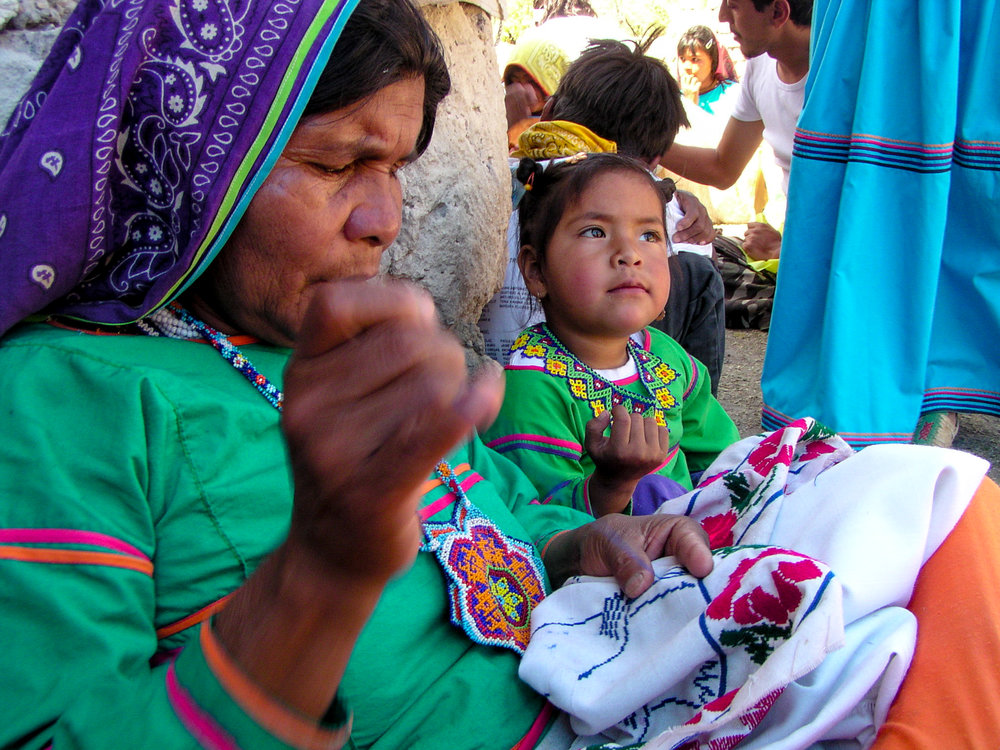 Mother and daughter sowing some traditional Wixarika clothes. The Wixarika are renown for their bead work, as the one both of them are wearing