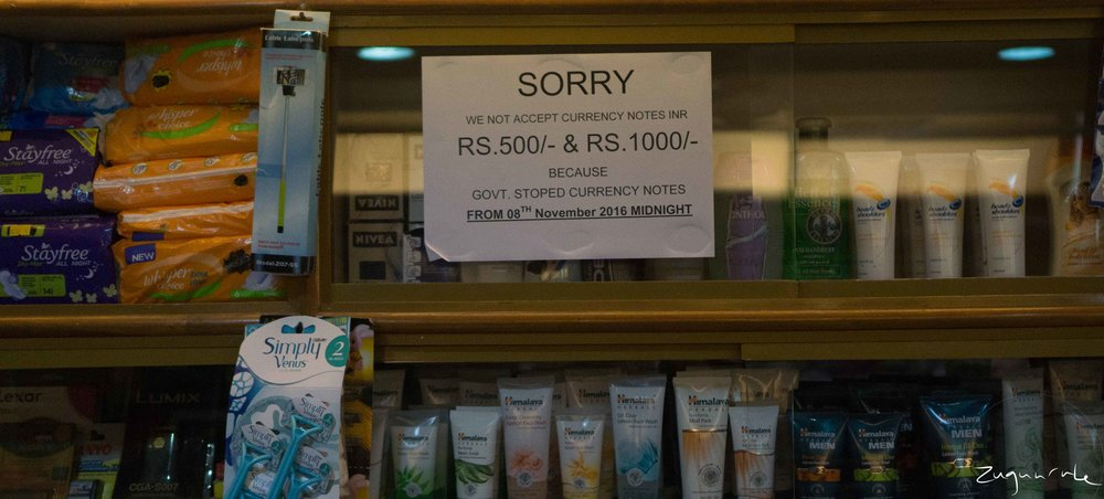 Sign behind the counter of a small convenience store (Udaipur)