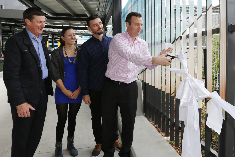 Cutting the ribbon to unveil the artwork at Glen Waverley train station.